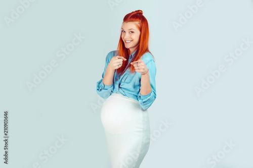 Charming pregnant woman pointing at camera Poster