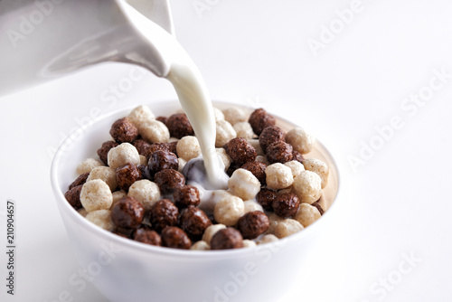 Canvas Print Chocolate cereal balls and milk