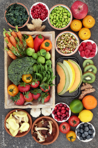 Poster Assortiment Super food concept with fruit, vegetables, herbs and spice. Foods high in fibre, anthocyanins, antioxidants, minerals and vitamins.