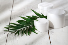 Cosmetic Cream And Beautiful Spa Containers On White Table