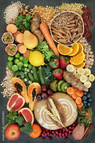 Poster Assortiment High fibre health food concept with fresh whole grain rye bread, cereals, grains, fruit, vegetables, nuts, legumes, herbs and spices. Foods high in omega 3, antioxidants, anthocyanins and vitamins.