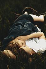 Couple Hugging Lying On Grass
