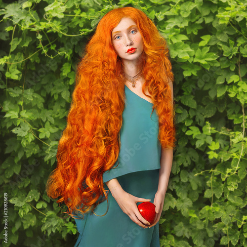 Young Redhead Princess With Very Long Hair In Blue Dress On