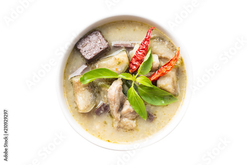 Green curry chicken (Kang Keaw Wan Gai) in a bowl isolated on white background, top view, Thai food