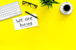 Leinwanddruck Bild - Search for worker, employee concept. We are hiring lettering on work desk on yellow background top view copy space