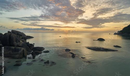 Staande foto Kust Colourful sunrise over sea lagoon and rocks on a tropical island