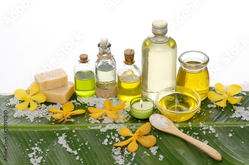 Poster Spa Spa set on banana leaf with bottle oil,salt in spoon, candle ,orchid,