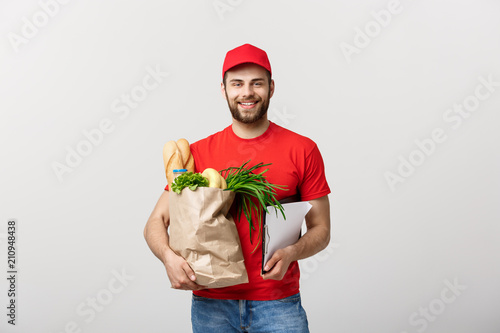 Keuken foto achterwand Food and grocery delivery courier man holding clip board. Isolated on White background.