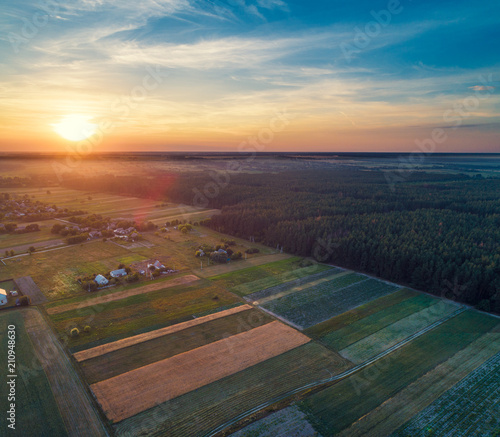 Keuken foto achterwand Diepbruine Aerial view of arable fields, pine forest and countrysides in evening