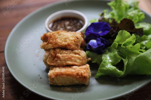 Fototapeta Vegan food appetizer japanese fried tofu on wood background vintage style obraz