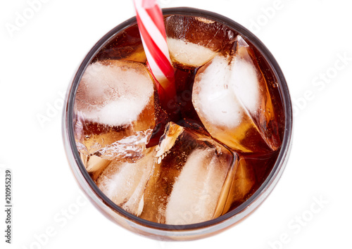 Fototapeta Cola in glass with straw and ice cubes isolated on white background. Soda with bubbles isolated on white. Refreshing non-alcoholic drink obraz na płótnie