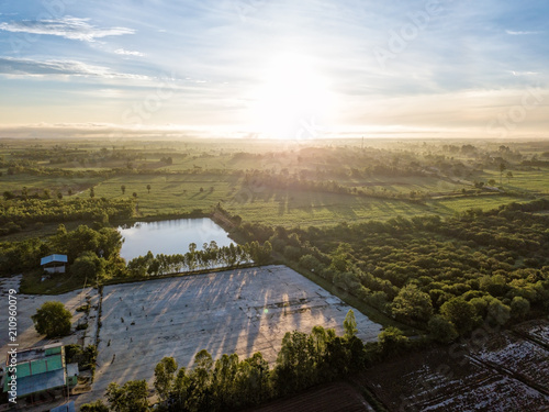 Foto op Plexiglas Blauwe hemel Beautiful aerial view of sunrise above the paddy fields at Northern Thailand. Aerial view from flying drone. Amazing nature landscape.