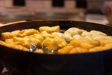 Selective Focus Deep Fried Dough Stick In Big Pan,Traditional Thai Street Food