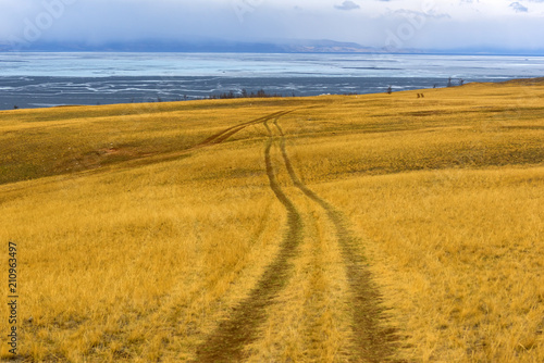 Staande foto Honing Track winding back roads in the mountains. Dirt road on Olkhon island in lake Baikal.