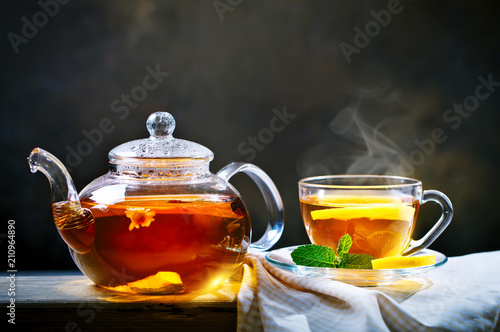 Cup of freshly brewed black tea,warm soft light, darker background.
