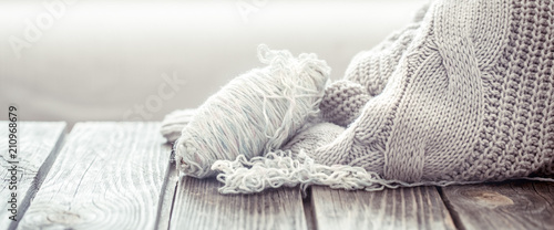 Fotografie, Obraz  knitted sweater on a wooden table