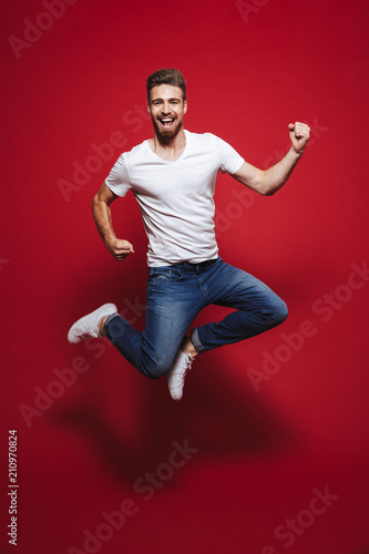 Papiers peints Kiev Full length portrait of a cheerful young bearded man