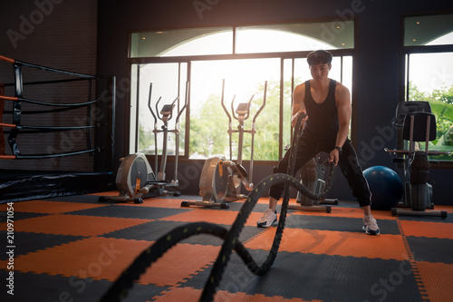Keuken foto achterwand Ontspanning Young fitness man in sports dress doing fitness exercise at gym,relax concept.