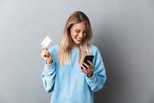 Pretty Young Blonde Girl In Blue Sweatshirt