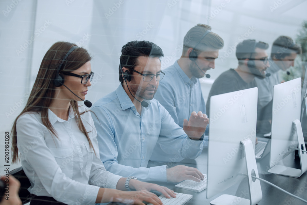Fototapeta call center staff at the workplace in the office