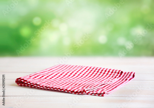 Red checked folded cloth empty blurred background.
