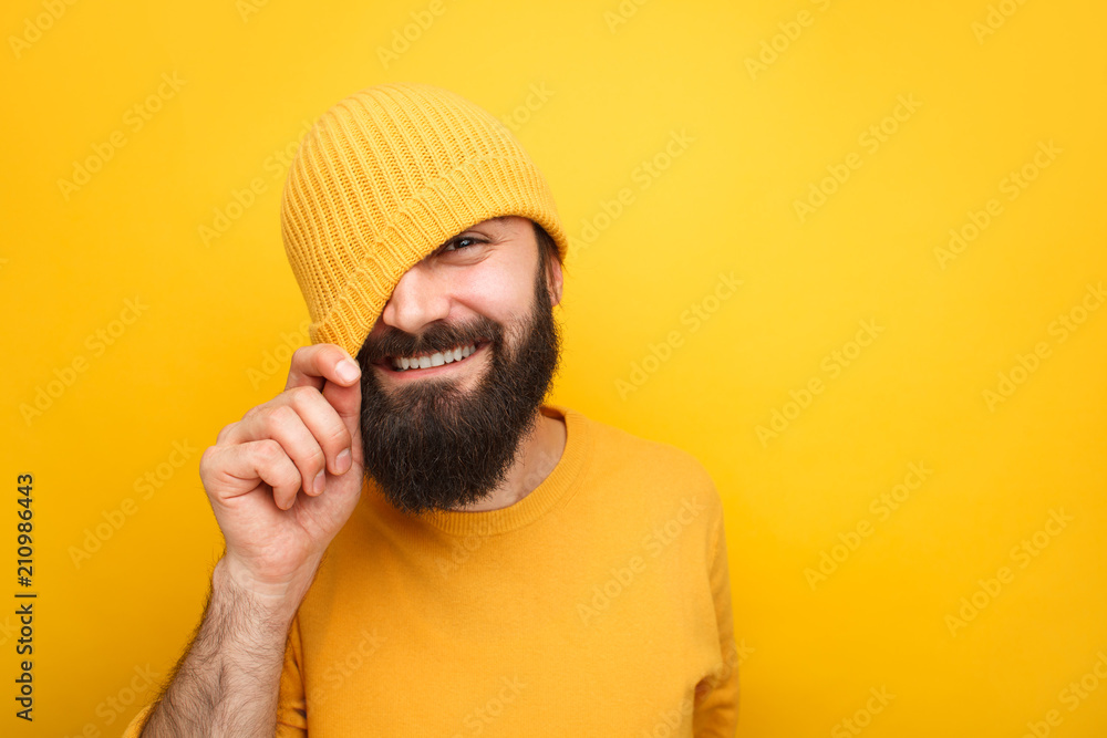 Fototapeta Handsome playful hipster in colorful hat