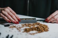 Female Hands Rolling Cigar Wit...