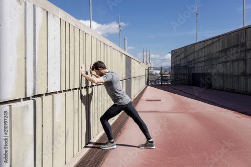 Keuken foto achterwand Baksteen muur Sporty man doing workout in a urban area, Barcelona, Spain.