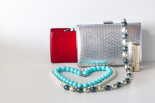 Purse, Handbag And Bijouterie With Lipstick On A Light Background