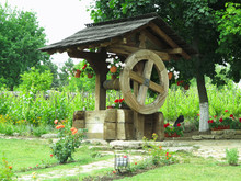 Vintage Old Wooden Water Well With Huge Wheel
