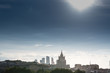 Moscow city historical skyline panorama with roofs and sun.