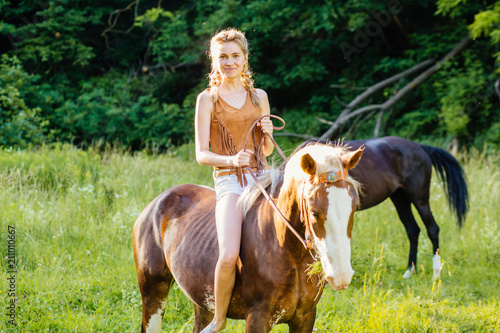 Beautiful woman on a horse Canvas Print