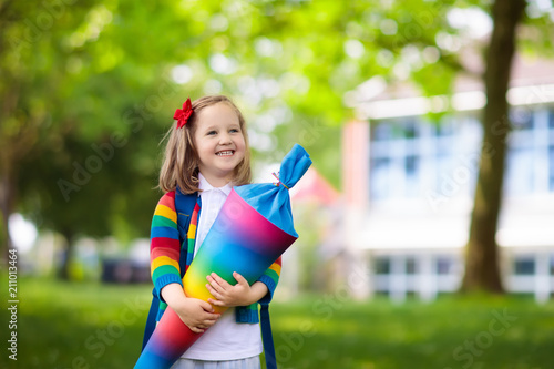 Fotografía Little child with candy cone on first school day