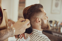 Barber Shakes Hair Off From Th...