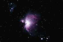 "M42, The Orion Nebula Is The Middle Star In Orion's ""sword"" And Is Visible With The Naked Eye.  Located About 1400 Light Years Away, It Is A Young Star-forming Gas Cluster."