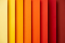 Abstract Background With Vertical Paper Sheets In Red And Yellow Tones
