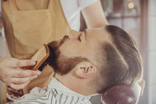 The Barber Combs The Man's Bea...