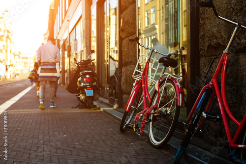 Papiers peints Con. ancienne Bicycles parked on the city street in Amsterdam in rays of the s