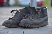 Old Bad Worn Out Dirty Ragged Boots Shoes