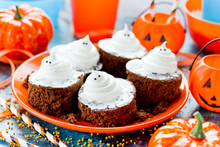 Halloween Ghost Brownies, Chocolate Cakes With White Meringue Ghosts For Treat Children To Halloween