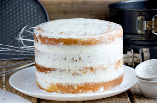 Vászonkép  Naked cake with cheese frosting cooking process