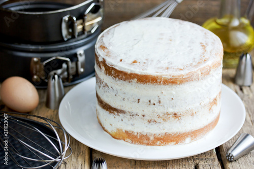 Fotografia, Obraz  Naked cake with cheese frosting cooking process