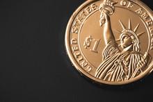 Golden One Dollar Coin Isolated On Black Background