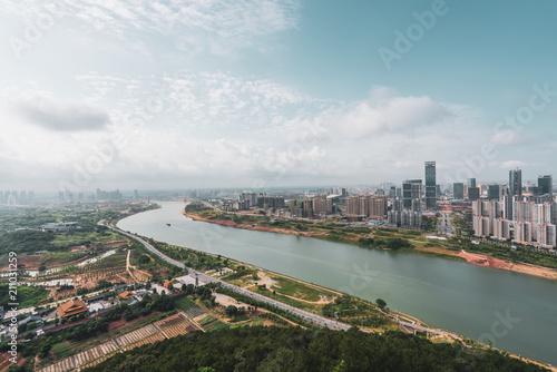 Cityscape of contemporary metropolis on river shore