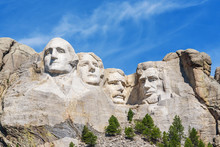 Presidential Sculpture At Mount Rushmore National Memorial, USA. Sunny Day, Blue Sky.