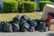 Bags Of Garbage At Curb For Pi...
