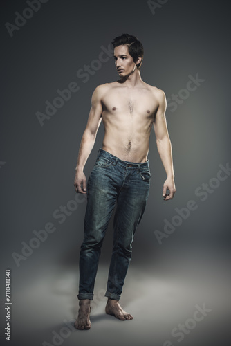 Foto op Canvas Akt athletic man in jeans