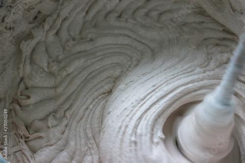 Fotografie, Obraz mixing of dry building mixes with mixers