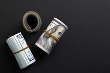 Rolled American Dollars On Black Background