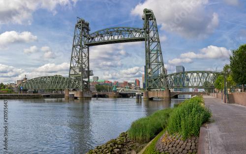 Spoed Foto op Canvas Rotterdam Historic iron railroad bridge in Rotterdam on a sunny morning